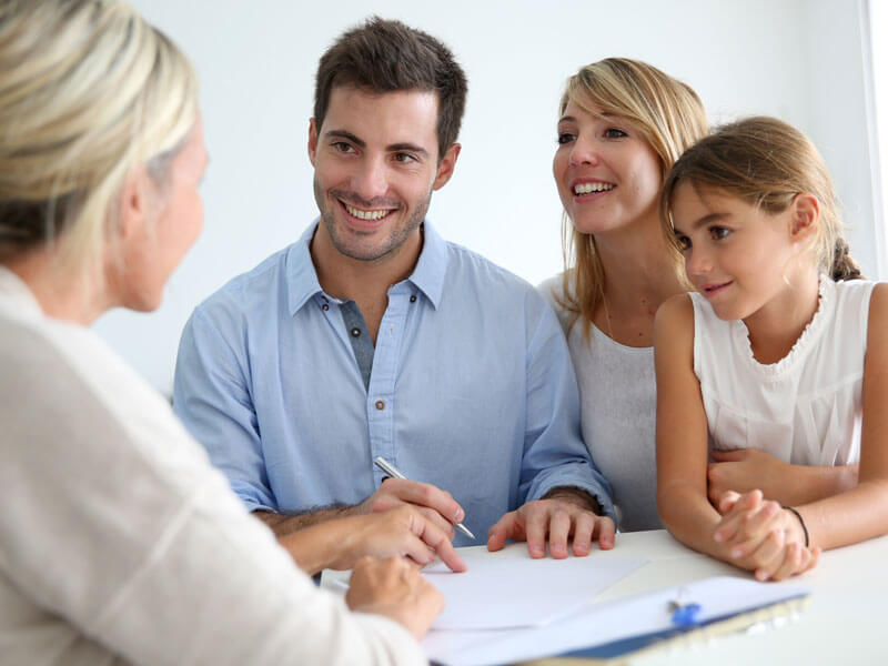 Young family working with a Sarasota financial planner to set up their wealth goals.